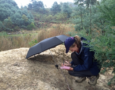 One of our wonderful field volunteers recording essential sample data in the rain